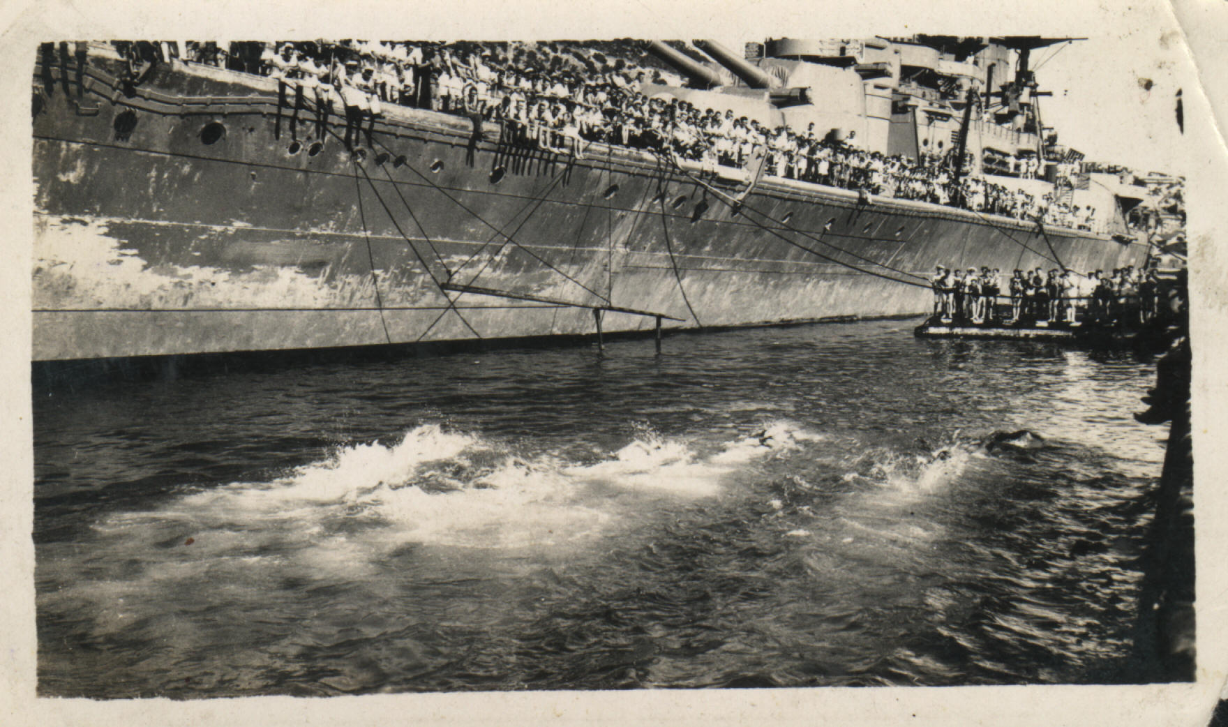 Swimminf races alongside Hood, 1940