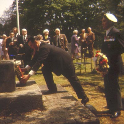 Ted Briggs lays a wreath during an H.M.S. Hood Remembrance Ceremony, 1970s or 1980s