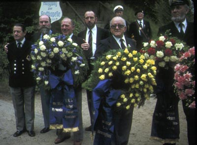 German veterans holding wreaths