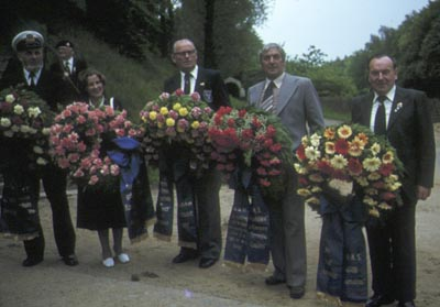 Nobby Clark and Germans holding memorial wreaths