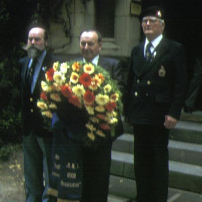 Ken Clark laying a wreath at the Bismarck memorial