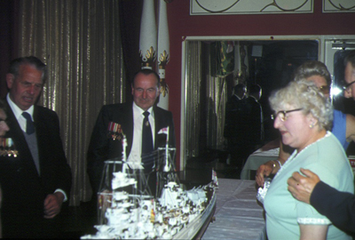 People viewing a model of H.M.S. Hood