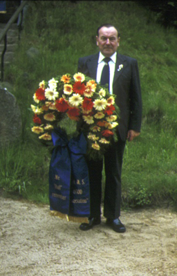 Ken Clark holding the H.M.S. Hood Association wreath