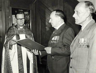 Ken Clark and Harry Purdue presenting a Roll of Honour to the vicar of St Ann's Church