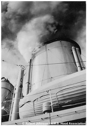 The aft funnel emitting smoke and steam, circa 1933 or 1934