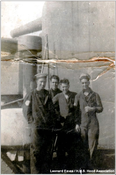 "Crewmen posing on the port side of ""B"" turret circa 1940 or 1941"