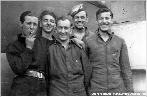 Crewmen posing near one of Hood's boats circa 1940 or 1941