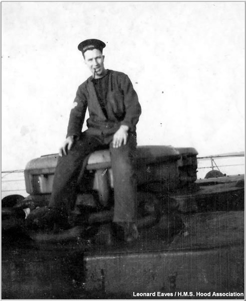 Leonard sits on one of Hood's forecastle capstans circa 1940 or 1941
