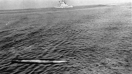 Hood fires a torpedo