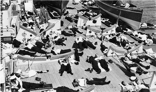 Crewmen resting on Hoods boat deck