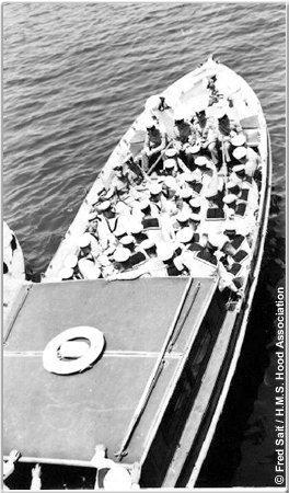 H.M.S. Hood crewmen prepare to go ashore