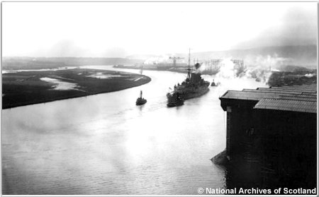 H.M.S. Hood departing Clydebank for trials