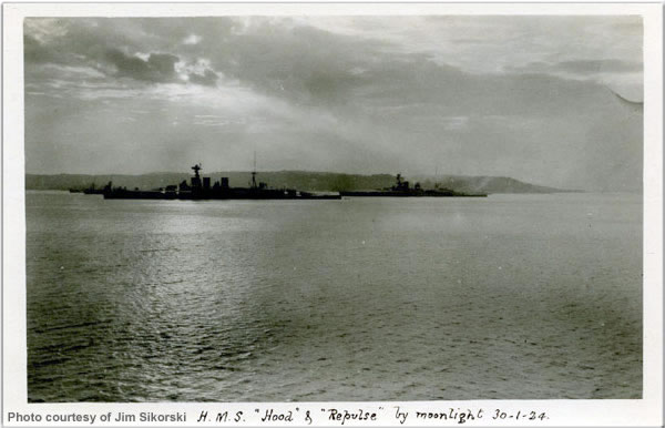 H.M.S. Hood and Repulse in a nighttime photo taken at Ceylon