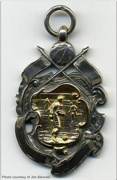 Football medal won by ERA P. Honton, H.M.S. Delhi, 1922-23