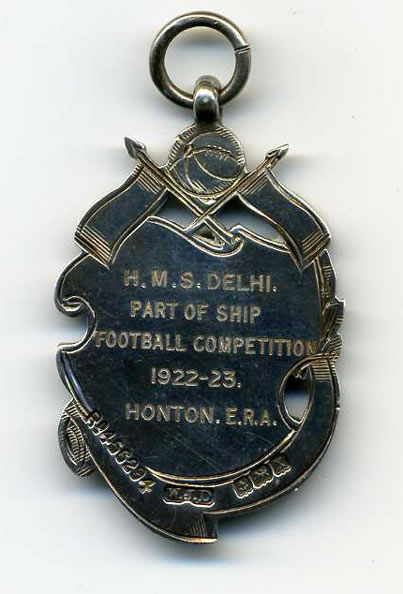 Reverse of football medal won by ERA P. Honton, H.M.S. Delhi, 1922-23
