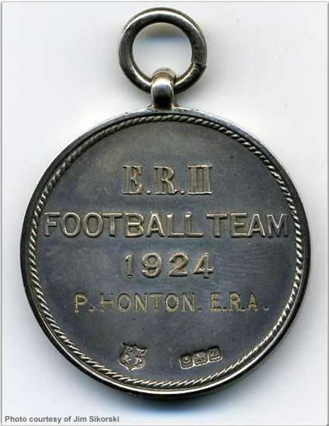 Reverse of football medal won by ERA P. Honton, 1924