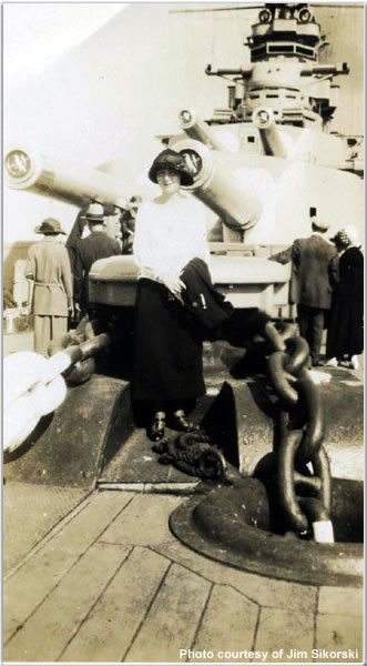Lady sitting atop one of Hood's capstans