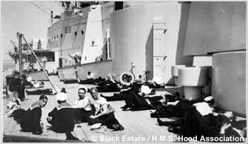Sailors lounging abreast H.M.S. Hoods forward gun house group, circa 1937 or 1938