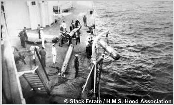 Retrieving a practice torpedo alongside the port side of the quarterdeck