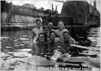 Sailors swimming in the dock