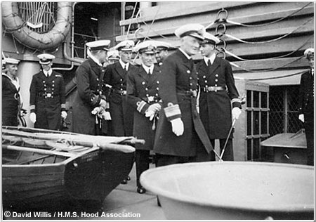 Vice-Admiral William James inspecting the ship